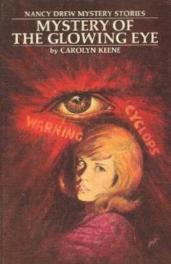 book cover of The Mystery of the Glowing Eye