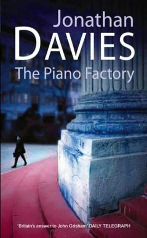 book cover of The Piano Factory