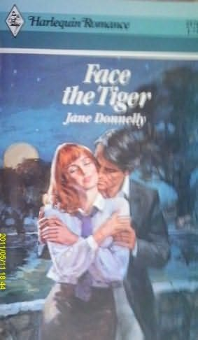 book cover of Face the Tiger