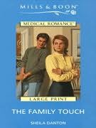book cover of The Family Touch
