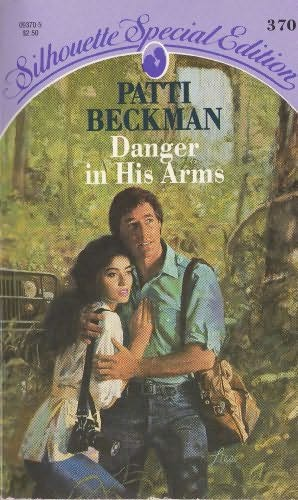book cover of Danger in His Arms